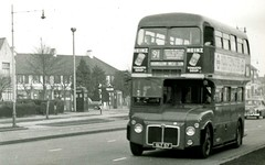 Dec 1957 -  RM2 -  Prototype AEC/Park Royal Routemaster in Red livery.  Great West Road, Hounlow. (RTW501) Tags: routemaster prototype rm2 slt57 aec parkroyal redlivery route91 greatwestroad drwho tardis airraidsiren policebox