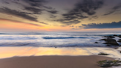 Beach and Sunrise Seascape with Streaky High Cloud (Merrillie) Tags: daybreak sunrise waterscape cloudy australia pastels nsw centralcoast clouds sea newsouthwales rocks earlymorning morning water landscape ocean nature sky pink coastal seascape outdoors killcarebeach dawn coast killcare waves