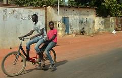 Gambia- Brikama (venturidonatella) Tags: gambia africa thegambia persone people gentes gente portrait portraits ritratto ritratti bicicletta bici bike ragazzi boys street strada streetscene streetlife colori colors nikon nikond500 d500 kombo kombocentral