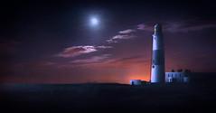 Lighthouse On Ocean's Shore (jarr1520) Tags: landscape seascape night moon stars clouds light ocean sea lighthouse buildings rocks texture