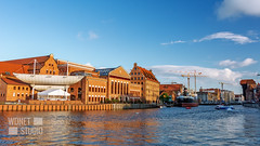 Motlawa river in Gdansk (WDnet) Tags: crane city poland gdansk architecture historic water building europe medieval polish landmark port old historical travel tourism harbor river town riverside motlawa reflection danzig cityscape baltic marine summer destination tourist culture famous zuraw sea promenade wooden european monument sightseeing attraction pomerania people philharmonic holiday visitor panoramic downtown journey unesco ngc