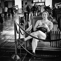 Crossed my mind (Maureen Bond) Tags: ca maureenbond unionstation blackwhite iphone woman lady girl sitting glasses waiting transportation traveling legscrossed ropedin streetwork