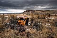 Humboldt County, Nevada (paccode) Tags: wreck d850 lonely desert bushes brush serious quiet snow fence abandoned mountain landscape hills creepy winter solemn jalopy scary forgotten mesa farm field orovada nevada unitedstates us