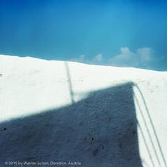Shadow, Island of Santorini, Greece (WernerSchoen) Tags: santorini thira greece wall shadow blue analog yashica 6x6 film abstract kykladen cyclades fuji schatten blau himmel minimalistic quadratisch griechenland mauer