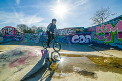 You're gonna be a star (Paul Wrights Reserved) Tags: bmx bmxing starburst sun sunstars graffiti bike biker cycling cyclist shadow reflection reflections reflectionphotography shadows colour colours coloured city innercity vibrant puddle wall sky lodon young youth