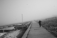 into the mist (photomaster22) Tags: misty foggy beach seaside pebbles boat walk walker person