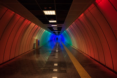 a place of hot and cold / loneliness can be a form of art (Özgür Gürgey) Tags: 20mm d750 nikon nispetiye voigtländer architecture colorful lines people perspective reflection station street subway symmetry tunnel istanbul