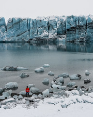 The Girl And The Icebergs (JH Images.co.uk) Tags: iceland glacier iceberg ice water reflection girl standing snow person red