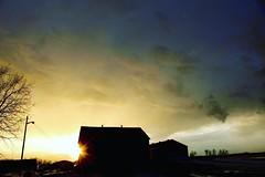 (jessalynn_sammons) Tags: sunburst sun shotoncanon canoncanada canon blue green sky clouds storm colours silhouette barn sunset