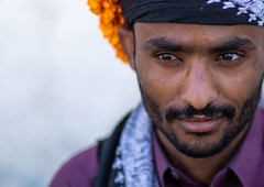 Portrait of a yemeni refugee wearing a floral crown on the head, Jizan Province, Addayer, Saudi Arabia (Eric Lafforgue) Tags: addayer adult arabia colorimage cultures decoration ethnography floralgarland flower flowercrown flowers headshot horizontal indigenousculture jizanprovince ksa males man marigold men middleeast middleeastern oneadultonly onemanonly oneperson orange photography plant portrait refugee saudiarabia saudi181946 tihama tradition travel tribal tribe war yemeni sa