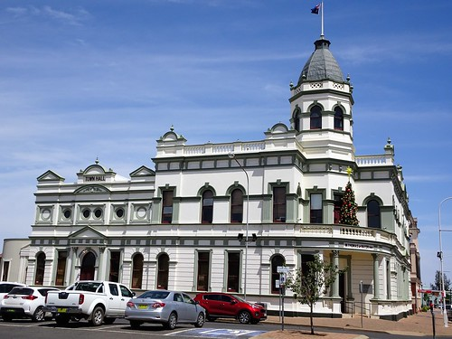 Forbes. The Town Hall facing Victoria Squ. Gold royalties permitted a grand structure. The  part with the corner tower  finished in 1891. The left hand part was the first Town Hall about 1870 when Forbes became a municipality.
