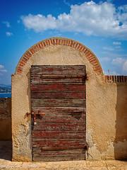 Door To Somewhere (lorinleecary) Tags: wood france trips hinges water sttropez rust red door clouds