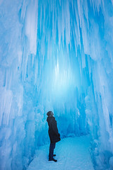 Person in the Ice Castle (Bluesky251) Tags: alberta beautiful blue bright canada cave cold color colorful daylight daytime edmonton freeze frozen glow ice icecastle lifestyle light outdoor outside person photography snow weather winter