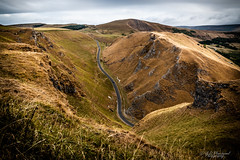 A snake in the pass (Through_Urizen) Tags: category derbyshire england landscape places winnatspass canon canon1585mm canon70d outdoor landscapephotography hill gorge hills countryside rural nature natural green grass rocks pass uk unitedkingdom greatbritain road route curves car vehicle