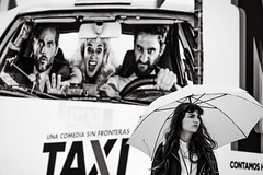 watch out! (Gerard Koopen) Tags: malaga spain espana straat street straatfotografie streetphotography candid streetlife blackandwhiteonly blackandwhite noir woman beautiful beauty umbrella festival movie film taxi urban sonyalpha sony a7iii 24105mm 2019 gerardkoopen gerardkoopenphotography