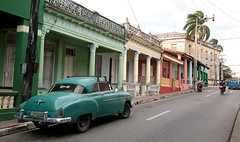 Pinar Del Rio Streetscape (peterkelly) Tags: digital canon 6d northamerica cuba cubalibre gadventures pinardelrio green car auto automobile oldcar street road downtown building column pillar motorcycle motorbike bike