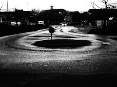 For Turning Around (cycle.nut66) Tags: black white grainyfilmartfilter roundabout aylesbury tesco island road roofline horizon sign tyre tracks cold monochrome grayscale petrol station olympus epl1 evolt micro four thirds mzuiko