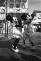 Mickey and Minnie Mouse Dancing. (lammyracer) Tags: disneyland disneylandonfilm ricoh500g ricoh fomapan mickeymouse minniemouse mainstreetusa rangefinder blackandwhite