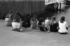 Gathering  (FP4+) (Harald Philipp) Tags: auckland newzealand viaduct harbor harbour water girls women gathering steps bnw blackandwhite monochrome analog film fp4 rangefinder kodakretina retinaiiic classiccamera