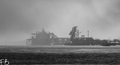 Christmas Eve River (frisiabonn) Tags: uk birkenhead merseyside england britain wirral monochrome black white greyscale bw cammell laird tranmere oil terminal fog sun shipyard weather dark river mersey kronviken crude tanker ship marine vessel