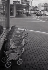 Strollers in Paeroa (Haruhara_Izzy) Tags: rollei 35 35mm film hp5 ilford canoscan 9000f
