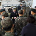 The commanding officer of USS Barry welcomes aboard ROK and Australia military officials for a ship tour