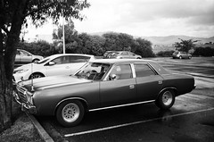1981 Chrysler Regal... (Matthew Paul Argall) Tags: kodakstar500af 35mmfilm blackandwhite blackandwhitefilm ilforddelta100 100isofilm car vehicle automobile transportation classiccar oldcar carspotting familysedan