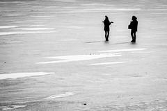 Candìd on the ice (Roberto Bendini) Tags: fiume fleuve blackandwhite 2019 canon person couple frozen icy river candid saintpetersbourg sanpietroburgo saintpetersburg russie russia