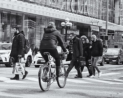 street biker, watch out (-liyen-) Tags: activeassignmentweekly aaw bw street bicycle urban candid winter cold fujixt2 streetphotography walking toronto ontario crossing
