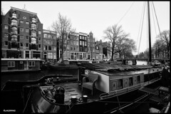 Amsterdam. (alamsterdam) Tags: amsterdam canal houseboat bridge architecture monochrome cars