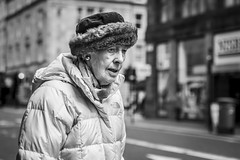 The North Face (Leanne Boulton) Tags: urban street candid portrait portraiture streetphotography candidstreetphotography candidportrait streetportrait streetlife old elderly woman female lady eyes face expression emotion mood hat scarf cold spring weather tone texture detail depthoffield bokeh naturallight outdoor light shade city scene human life living humanity society culture lifestyle people canon canon5dmkiii 70mm ef2470mmf28liiusm black white blackwhite bw mono blackandwhite monochrome glasgow scotland uk