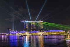 Marina Bay Laser Show (Simone Gramegna) Tags: laser singapore asia night nightscape hotel hotels marinabay marinabaysands marina water waterfront lights music show architecture city cityscape cityview skyline colours color merlionpark