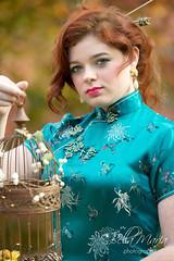 Red haired geisha (glasskunstler) Tags: autumn geisha model garden portrait bird birdcage greeneyes redhead oriental poutylips