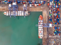 Top view of Container port and container ship transportation (anekphoto) Tags: port container shipping ship logistics cargo harbor export transport transportation industry trade delivery crane business terminal sea industrial dock top ports storage freight commercial loading unloading white vessel stack commerce truck maritime bulk containers blue gdp import red warehouse view day deliver cranes road car large singapore shang hai thailand