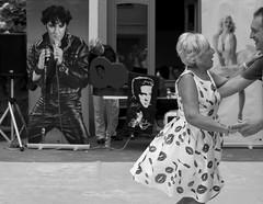 Dancing with Elvis (Claudia Merighi) Tags: black blackwhitephotos streetphotography street ricohimages people rockabilly rocknroll dancin dancers streetdancing steps passi piazza strassenfotografie elvis bnbwbwbiancoenero blackandwhiteonly noiretblanc blackandwhitephotography