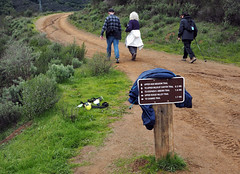 Leaving it behind (LeftCoastKenny) Tags: ranchosanantonio hikers brush hill trail sign text clothing bottles