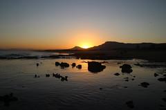 The sun setting on Christmas Day, Towradgi Beach (RossCunningham183) Tags: sunset towradgibeach wollongong nsw australia beach ocean sea rockpool reflection mtkiera mtkembla ripples waves