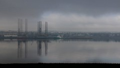 Atmospheric view of the docks in Dundee (milnefaefife) Tags: 100xthe2019edition 100x2019 image25100 firthoftay fife newportontay dundee tay coast scotland sea shore landscape fog mist clouds haar seascape docks oilplatform reflections