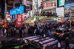 Times Square (Jocey K) Tags: sonydscrx100m6 triptocanadaandnewyork architecture buildings evening illumination billboards timessq nighttourhopandhopoffbus crowds trafficlights street road bikes