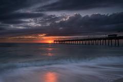 Sunset over the Venice Fishing Pier, Venice, Florida (diana_robinson) Tags: abigfave venicefishingpier sunset pier fishingpier longexposure smoothwater beach seascape gulfofmexico venice florida