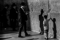 At the Wall-DSC_9306 (thomschphotography3) Tags: israel jerusalem westernwall streetphotography shadow religion jews jewish men boy child blackandwhite monochrome father son