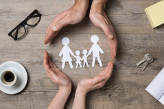 Family care (nithiyabhaskar) Tags: family care protection security insurance investment support home house parent paper chain unity hand closeup together father mother son daughter help social symbol concept togetherness issue mortgage loan future love protect italy