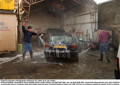 """Car Wash 2 (hoffman) Tags: british britishisles car cleaning daylight ec eec employment england english eu europe europeanunion foam greatbritain horizontal hoses hosing immigrant immigration labour lowpay male man men migration outdoors pricelist serviceindustry shed soap spray spraying street towerhamlets transport uk unitedkingdom vehicle washing water work working davidhoffman wwwhoffmanphotoscom london davidhoffmanphotolibrary socialissues reportage stockphotos""""stock photostock photography"""" stockphotographs""""documentarywwwhoffmanphotoscom copyright"""