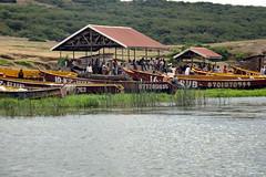 Fishing Village (pbr42) Tags: africa uganda queenelizabethnationalpark nationalpark hdr water lake crater h2o kazinga kazingachannel nature village boat boats shore people