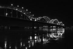 icy reflections (David Sebben) Tags: centennial bridge mississippi river black white monochrome ice reflection winter cold
