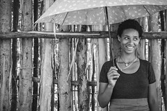 Umbrella (u c c r o w) Tags: happy girl portrait umbrella blackandwhite wood wall ethiopia ethiopian woman smile