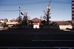 Centre (OzGFK) Tags: 35mm fuji fujiindustrial100 japan nikonfm2n tokina1116mm tokyo analog bright city film pushedtwostops sunny travel symmetry temple silhouette urban
