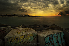 Gold Sunrise in Barcelona (Gabriel Castro Vidal) Tags: sunset dawn riverbank sunrise water horizon over coastline seascape morning sunlight light sky beach clouds sun coast rocks outdoors summer travel costa barcelona amanecer atardecer luz grafitti playa nubes cielo spain