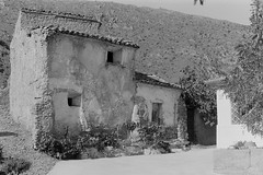 Adobe brick house (davidgarciadorado) Tags: valle del jalón zaragoza aragón spain adobe traditional construction hause 35mm 135 film blackandwhite om2 om2n zuiko om midday sun