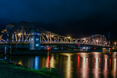 high street bridge in the rain (pbo31) Tags: bayarea california eastbay alamedacounty nikon d810 color night dark black march 2019 boury pbo31 urban oakland lightstream motion traffic roadway bridge alameda reflection high draw yellow rain wet weather